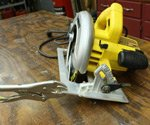Locking pliers clamped to base of circular saw for ripping.