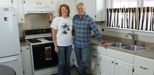 Homeowner Danette Richards and Danny Lipford in remodeled kitchen.