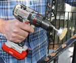Using rotary wire brush drill attachment to remove rust from wrought iron.