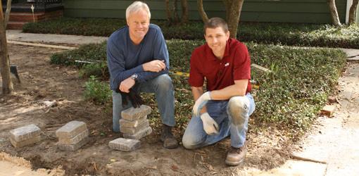 Danny Lipford and Andy Morton preparing to lay paver driveway.