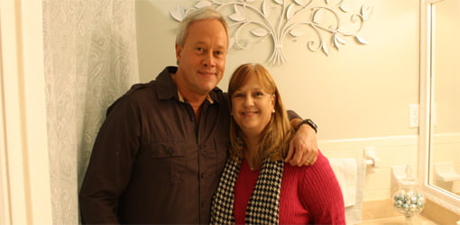 Danny Lipford and homeowner Jackie Cruthirds in remodeled bathroom.