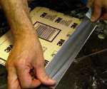 Applying duct tape to sandpaper.