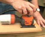 Sanding wood with power sander