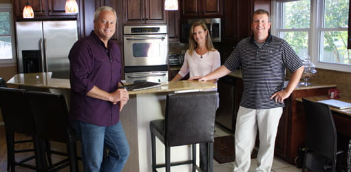 Danny Lipford in kitchen with homeowners Suzanne and Sammy Massingill.