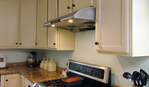 Stainless steel range hood over stove.