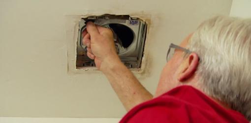Danny Lipford replacing old bathroom vent fan.