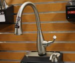 Kitchen faucet mounted on wall in store display.