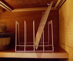 Office organizer in kitchen cabinet for storage.