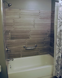 Tile tub surround with glass tile accents.