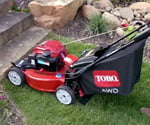 Cutting grass in yard with Toro Recycler Lawn Mower.