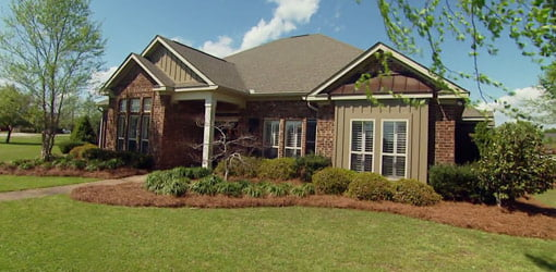 Brick house with front porch.