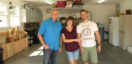 Danny Lipford with Courtney and Bajorn Gaylord in garage after makeover.