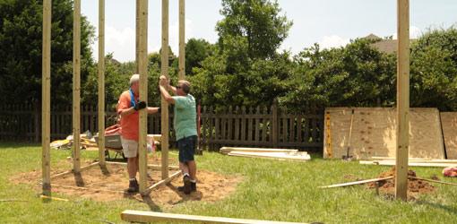 Danny and Allen installing playset posts.