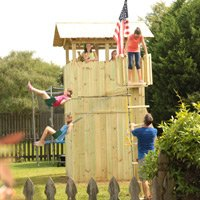 Children swinging on completed playset.