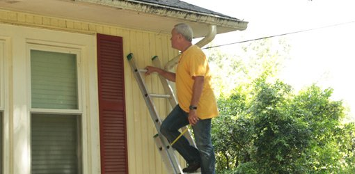 Danny Lipford working on eaves.