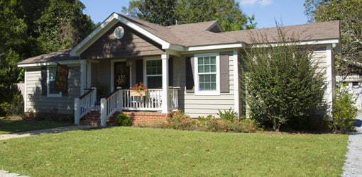 Exterior of house with vinyl siding and gable front porch.