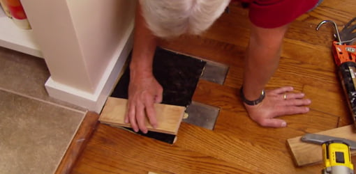 Patching hole in wood floor.