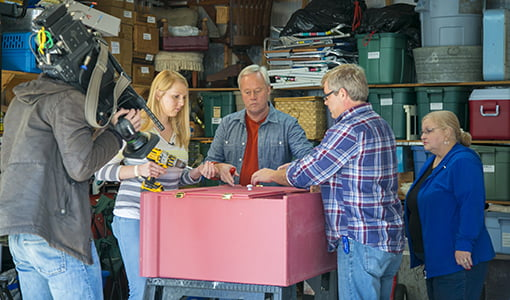 Chelsea, Danny and Allen work on the old hutch.
