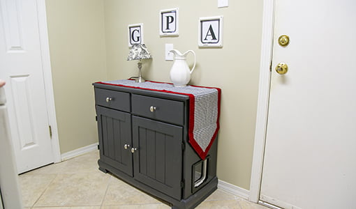 Up-cycled hutch and recycling chutes.