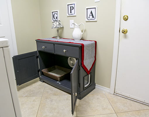 This up-cycled hutch is now a cabinet for the cat's litter box.