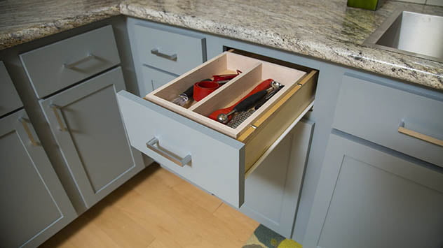 Adding a tray to a kitchen drawer allows for twice the storage space.