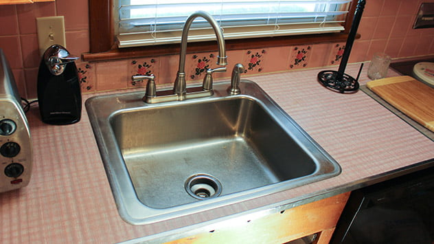 We repair the loose faucet in Tamera's kitchen.