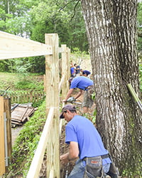 crew working on building a fence