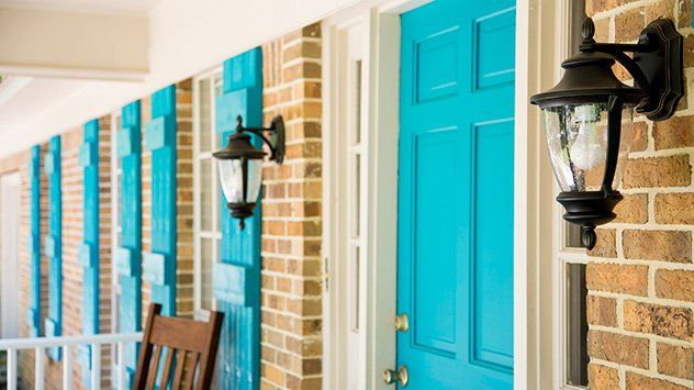 New shutters, a bold door and updated lights add to the curb appeal.