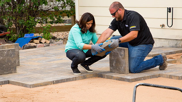 Monica and from Pavestone lay the new pavers.