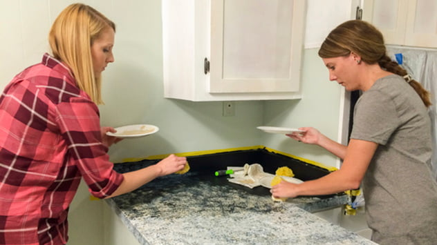Chelsea and Nicole give the countertops a faux granite finish.
