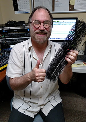 Our radio show producer, Dennis Gould, with the GutterBrush.
