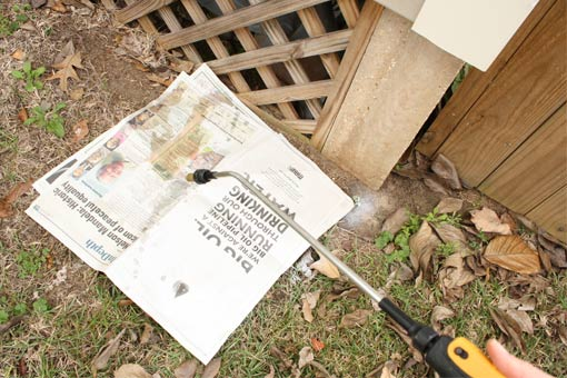 Using pump-up sprayer to wet down newspaper