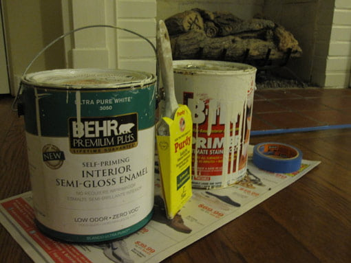 Paint, primer, and brush to paint hearth.