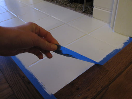 Removing painter's tape around hearth.