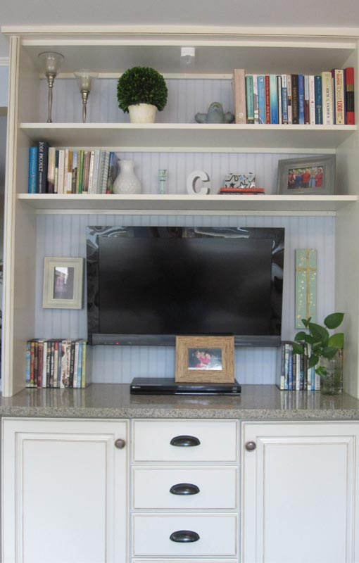 Painted bead board with TV hung on wall