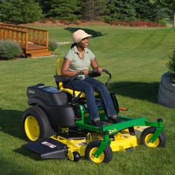 Cutting a lawn on a John Deere riding mower.
