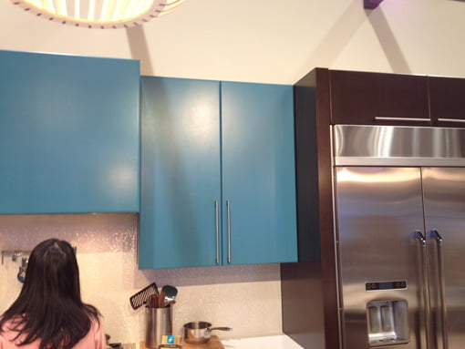 Blue hanging kitchen cabinets.