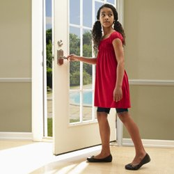 Girl leaving house with Schlage entry lock with built-in alarm