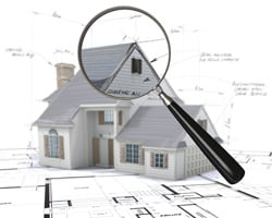 House with magnifying glass and plans