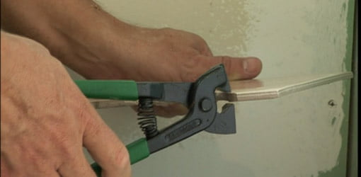 Tile nippers are used to break off small amounts of tile.