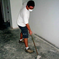 Scraping old adhesive off floor