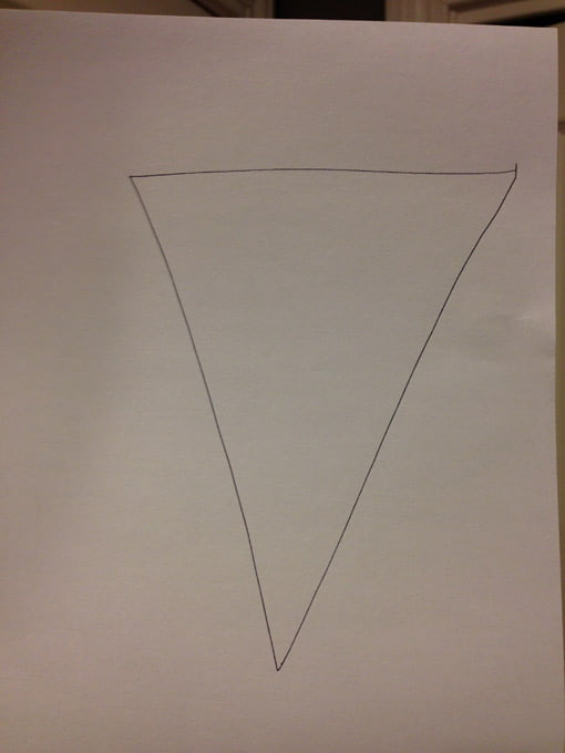 triangle drawn on white paper