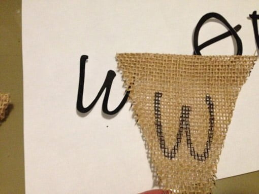 Letter W traced on burlap next to W cut from paper
