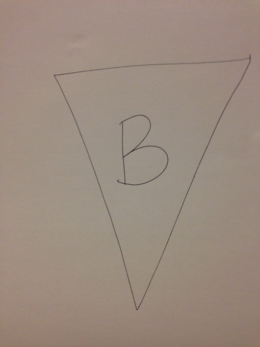 The letter B drawn inside triangle
