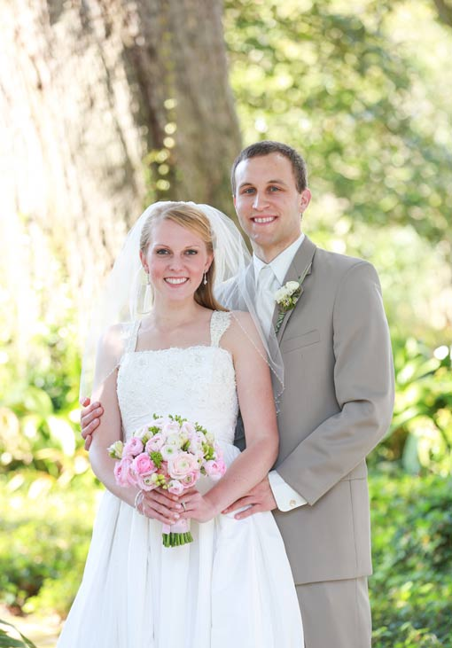 Bride and groom in front of large oak tree