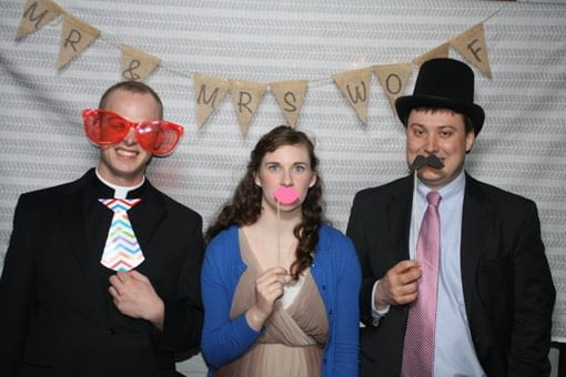 Wedding photo booth with burlap bunting pink lips big glasses top hat and mustache