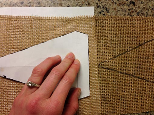 diamond shaped template traced onto burlap with space between