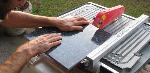 Cutting granite tile.
