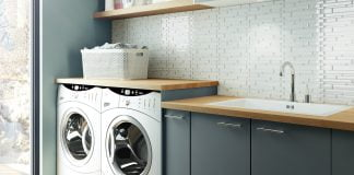 Laundry room featuring European style cabinets from Cabinets To Go