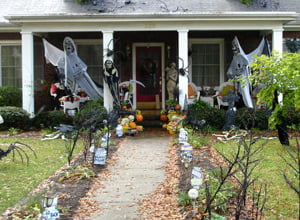 Yard and house decorated for Halloween.